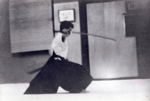 "OKANO TOMASABURO SENSEI HEAD MASTER OF THE KENKO HOMBU JUKU, HACHIOGI CITY, JAPAN. MID KATA ""INYOSHINTAI"" AT NY SAMURAI DOJO 1964"