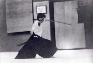 "OKANO TOMASABURO SENSEI HEAD MASTER OF THE KENKO HOMBU JUKU, HACHIOGI CITY, JAPAN. MID KATA ""INYOSHINTAI"" AT NY SAMURAI DOJO 1964"